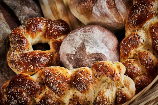 Home artisanal bakery during Coronavirus pandemic isolation. Group of Fresh mixed breads and rolls stock photo