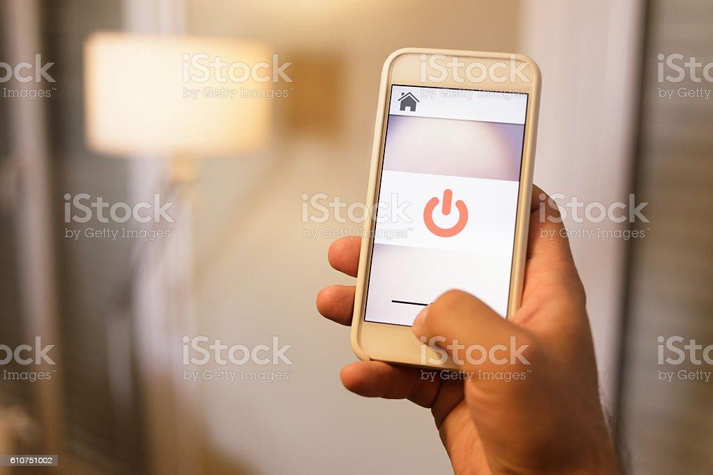 Home Automation Application on Smart Phone Controlling Lighting stock photo
