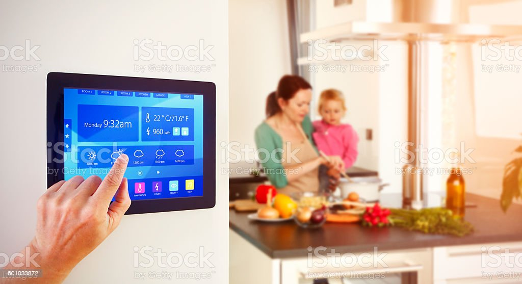 Home automation in the kitchen stock photo