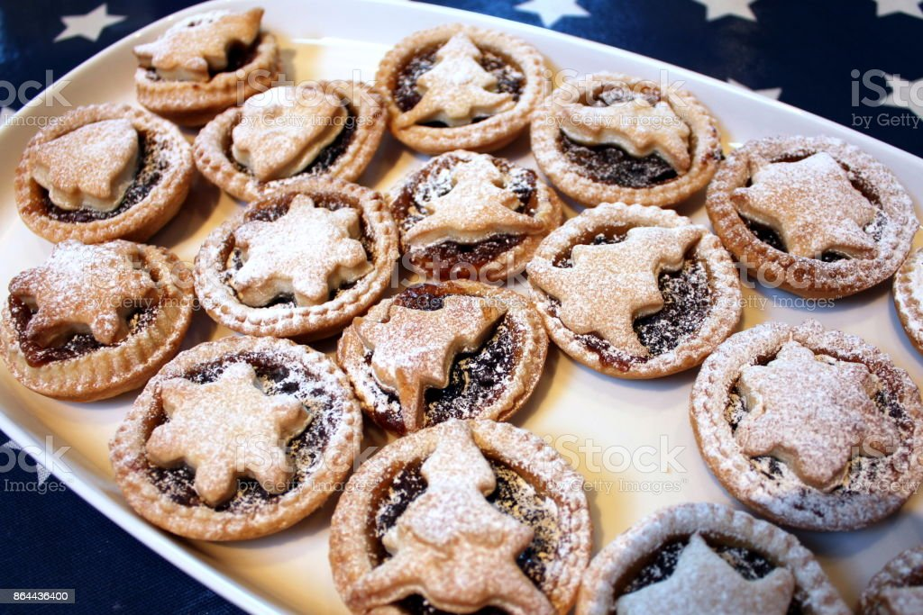 Home baked Christmas mince pies on a white tray stock photo