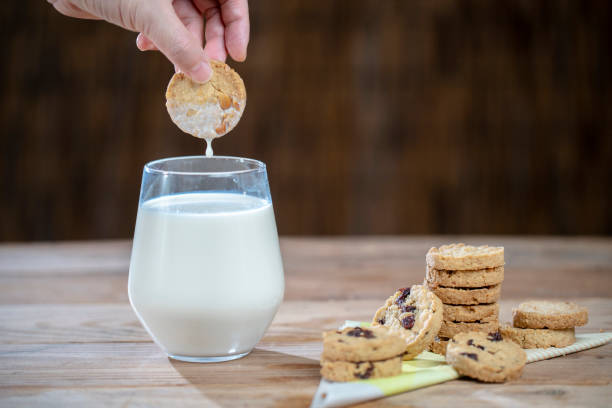 home baked cranberry cookies and glass of milk