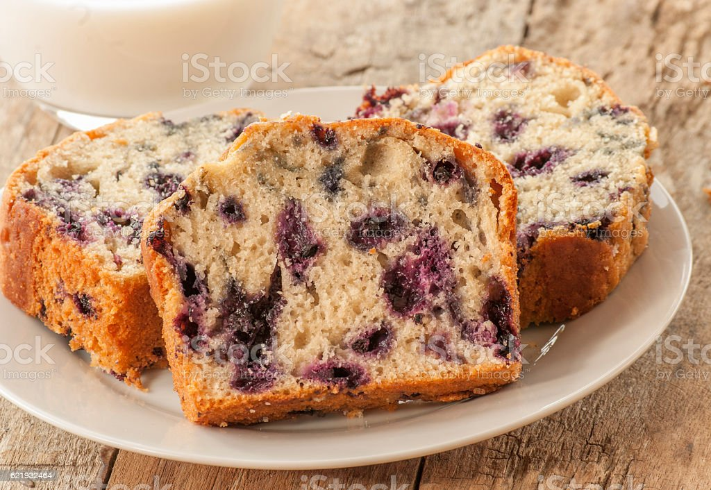 Home baked lemon cake with blueberries stock photo