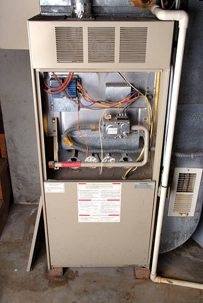 home basement furnace unit - furnace stock photos and pictures