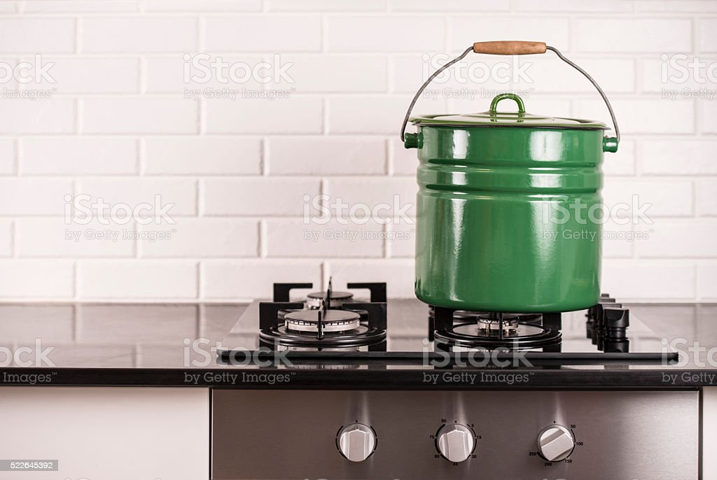 Home beer brewing pot on gas stove. stock photo