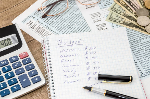 home budget with tax form, money and calculator stock photo