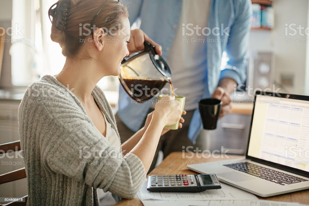 Photo of a young couple calculating home finances