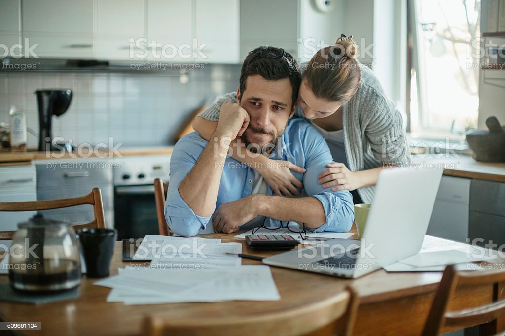 Photo of a young couple going through financial problems