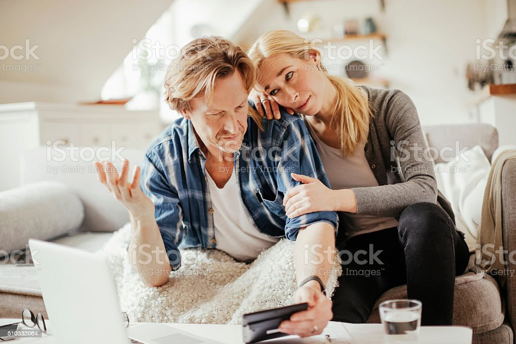 Photo of a mature couple calculating home finances