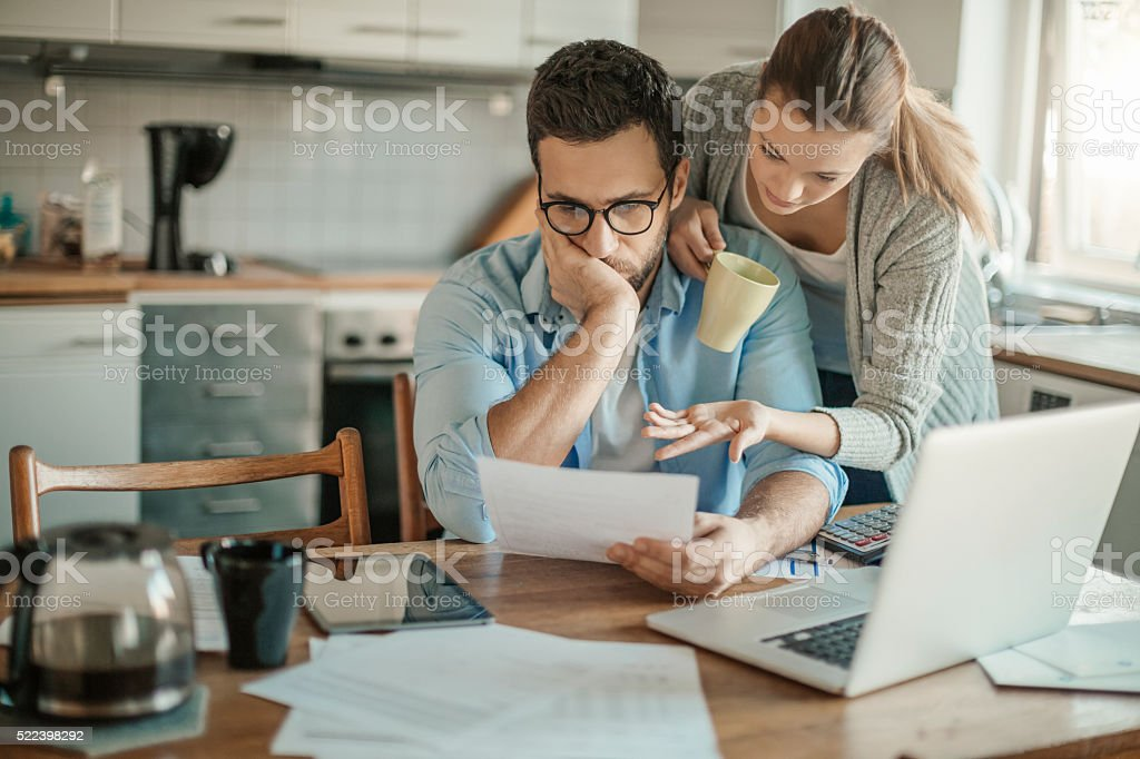 Home budgeting Photo of a young couple going through financial problems Adult Stock Photo