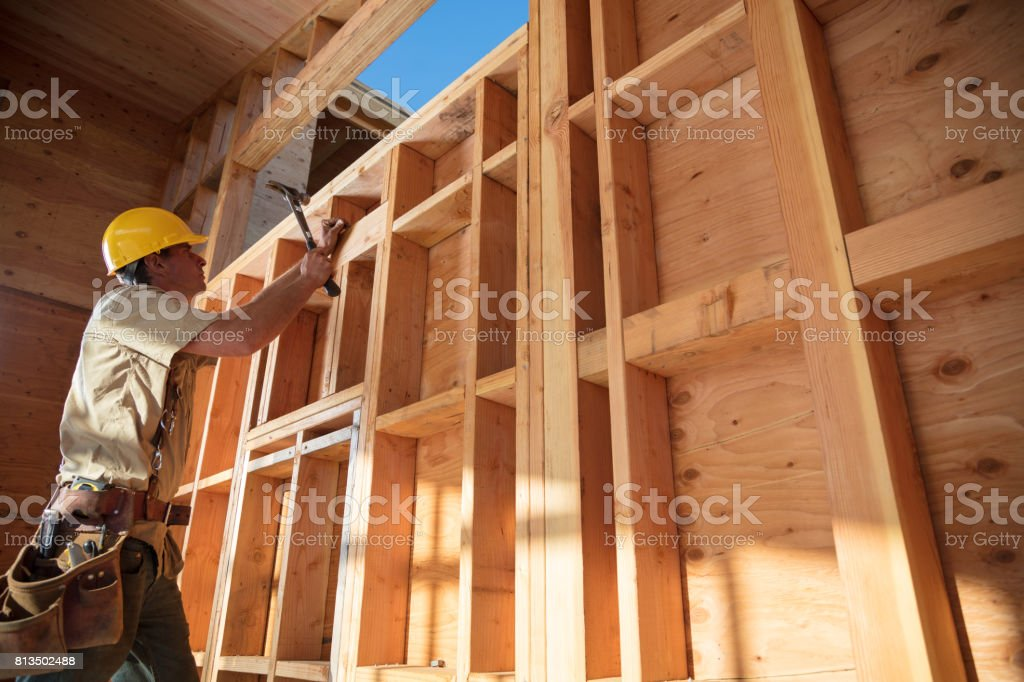 Home Building - Hammering stock photo