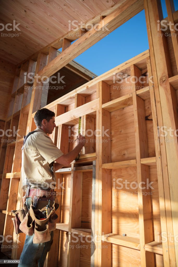 Home Building - Measuring stock photo
