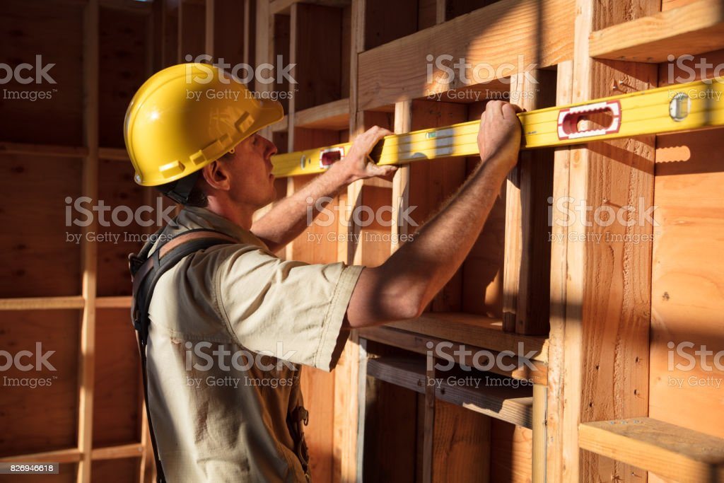 Home Building - Measuring Wall stock photo
