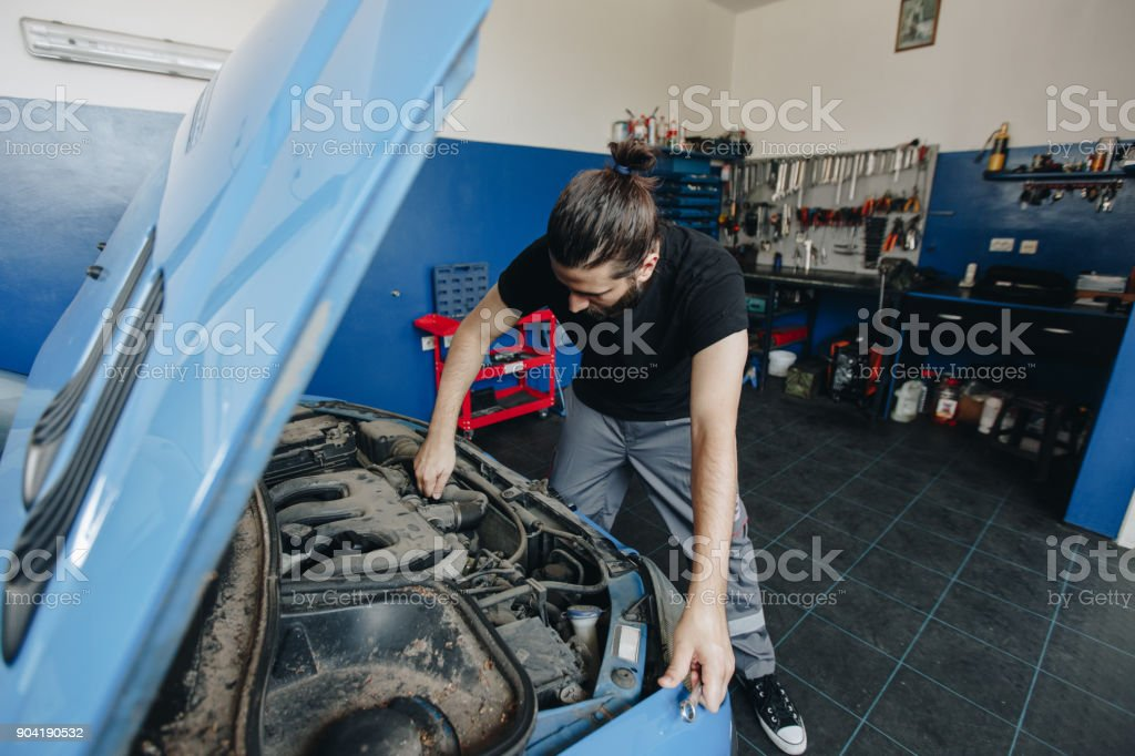 Home business as auto mechanic stock photo
