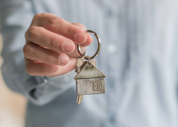 Home buyer or apartment sale agent giving key for leasing, security and ownership concept stock photo