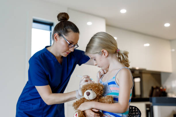 home call nurse giving child an injection at home - australian nurses stock photos and pictures