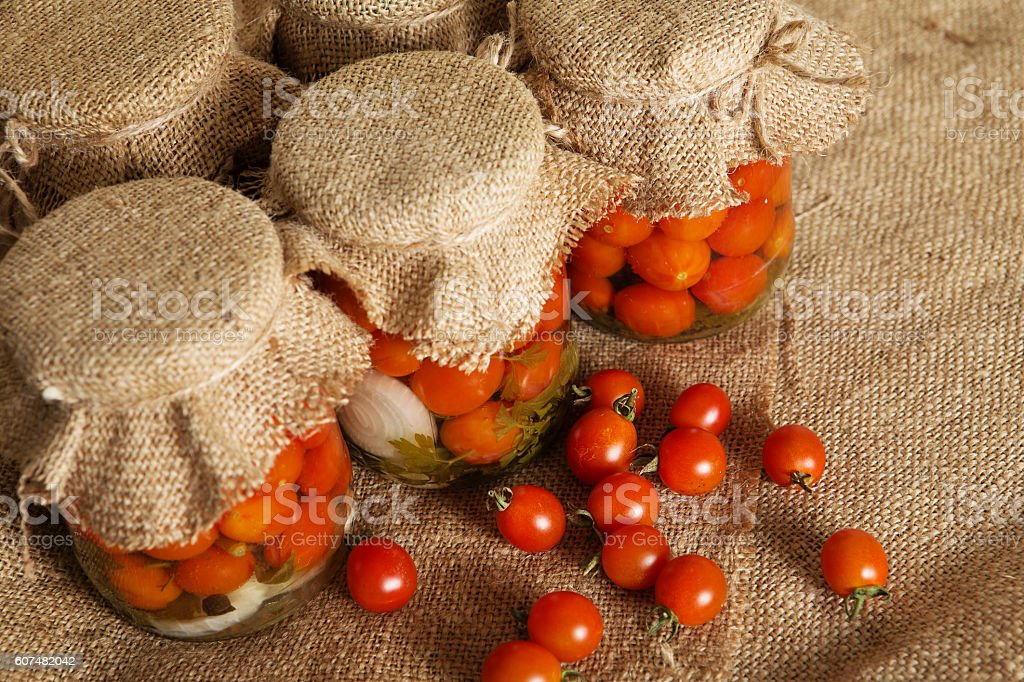 Home canning. Banks pickled tomatoes stock photo