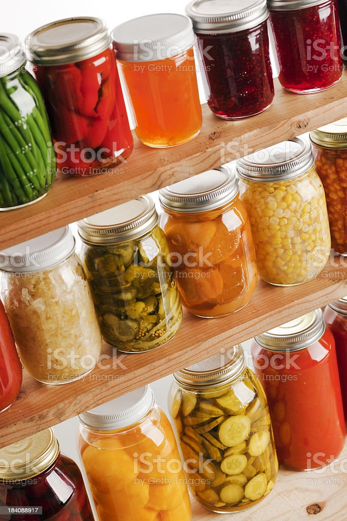 Home Canning of Summer Vegetables on Wooden Shelves Vt royalty-free stock photo
