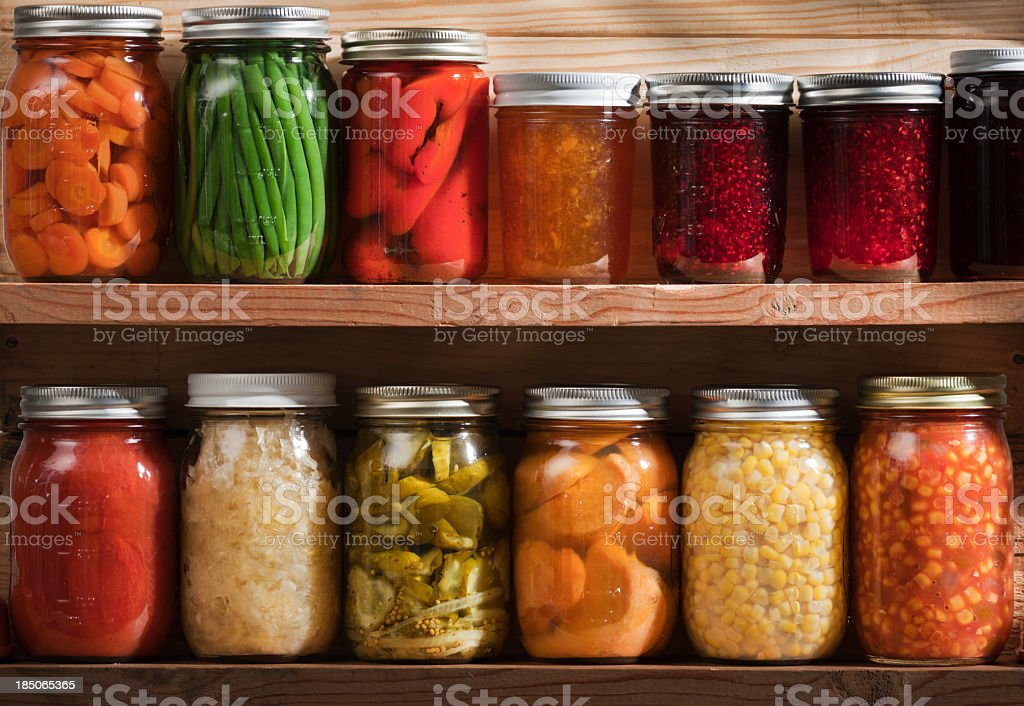 Home Canning, Preserving, Pickling Food Stored on Wooden Storage Shelves stock photo