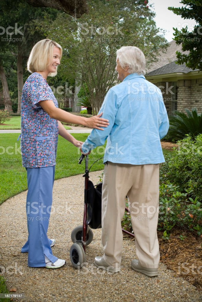 Home Care Nurse and Elderly Woman. royalty-free stock photo