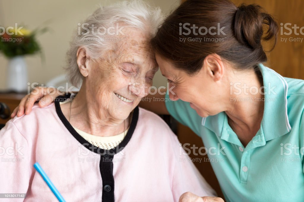 Home caregiver and senior adult woman - Dementia and Occupational...