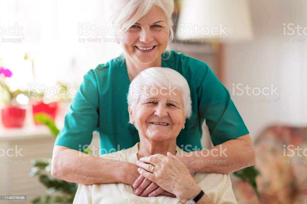 Home caregiver and senior adult woman