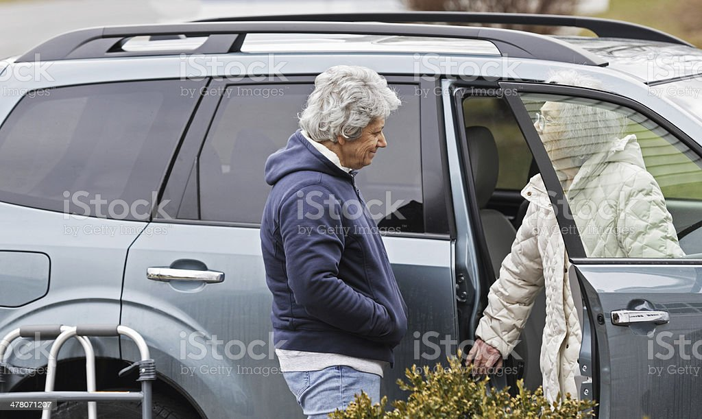 Home Caregiver Daughter And Elderly Mother Smiling royalty-free stock photo