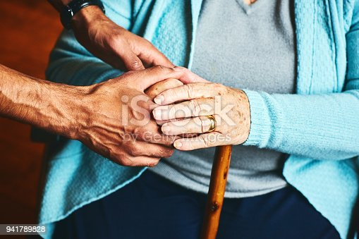 istock Home caregiver showing support for elderly patient. 941789828