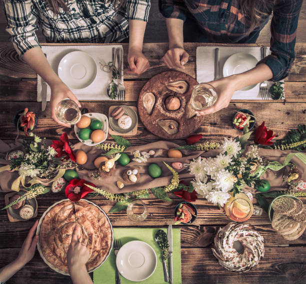home celebration of friends or family at the festive table - foodie stock photos and pictures