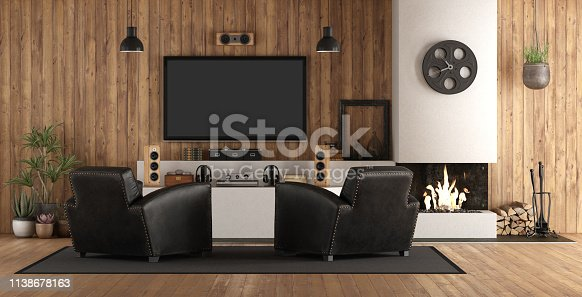 Home cinema in rustic style with black armchair, fireplace and wooden paneling - 3d rendering Note: the room does not exist in reality, Property model is not necessary