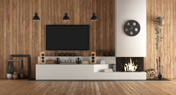 Home cinema in rustic style with fireplace stock photo