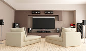 istock Home cinema room with two lounge chairs 177100713