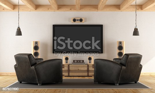 istock Home cinema system with vintage furniture 607922890