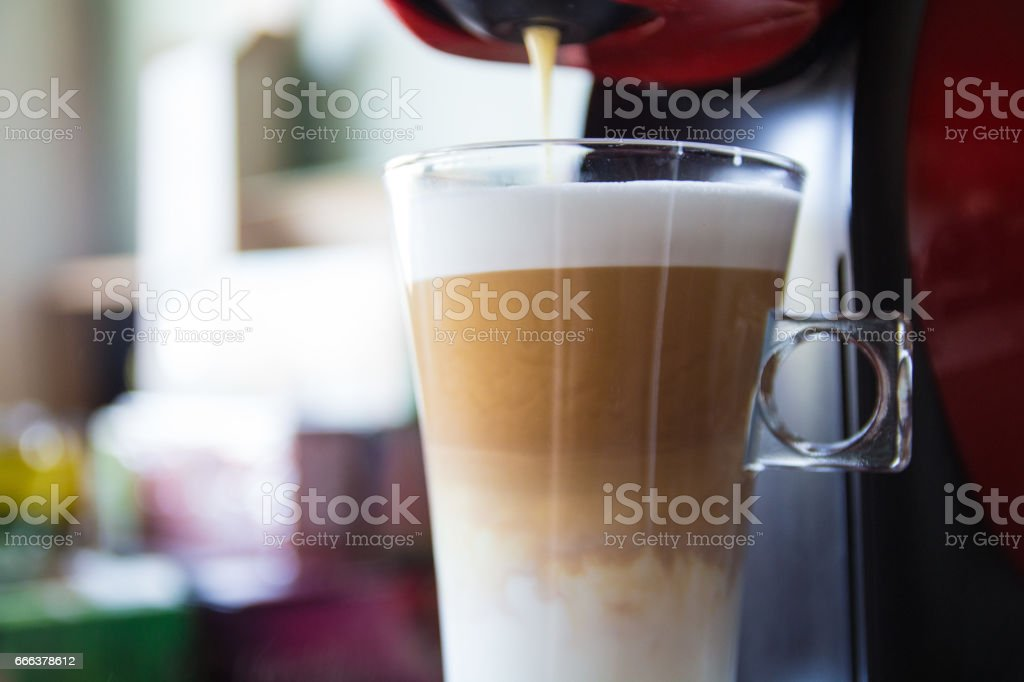 Home coffee machine making coffee in the kitchen stock photo