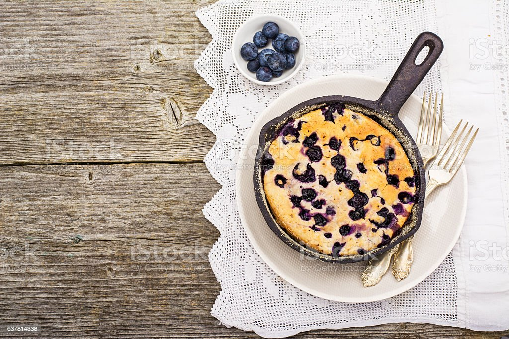 Home comfort food. Fresh blueberry pie in a cast iron stock photo