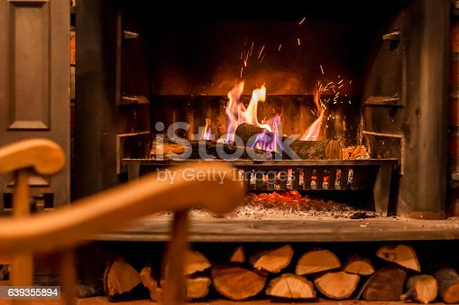 istock Home comfort. Rocking chair near the fireplace. 639355894