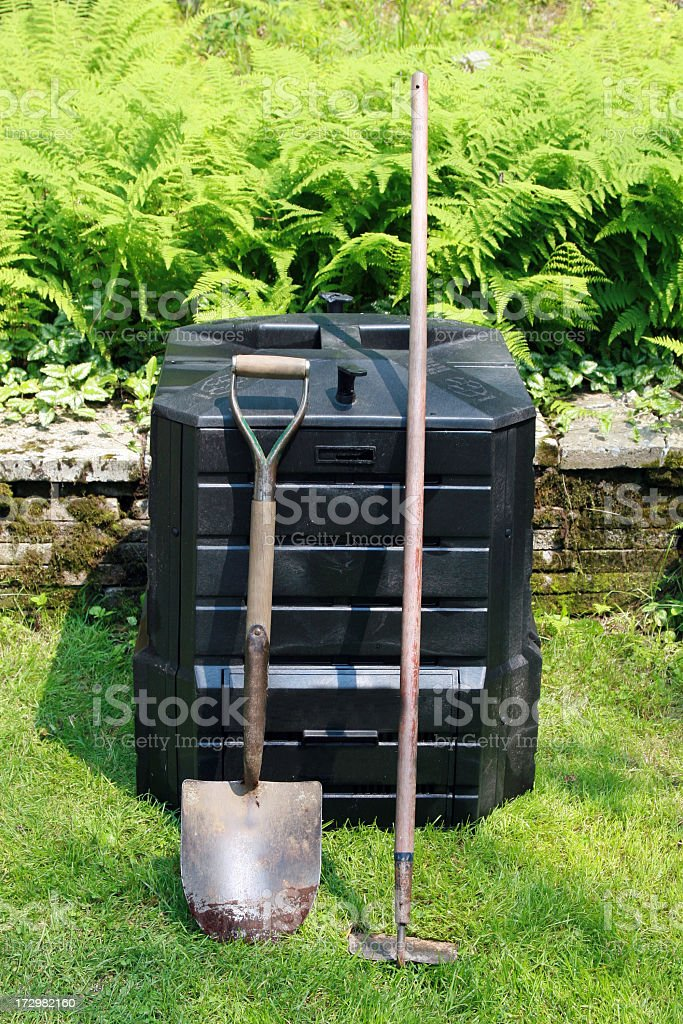 Home Composting Bin and Green Fern Background royalty-free stock photo