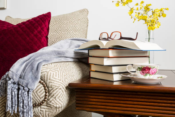 Home concept, Reading at home with book, glasses and a cup of coffee on a table in room on a relaxing afternoon stock photo