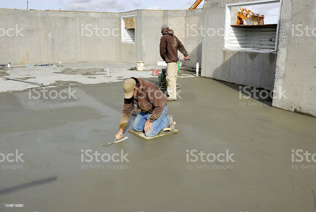 Home Construction - Finishing The Cement Of Basment Floor royalty-free stock photo
