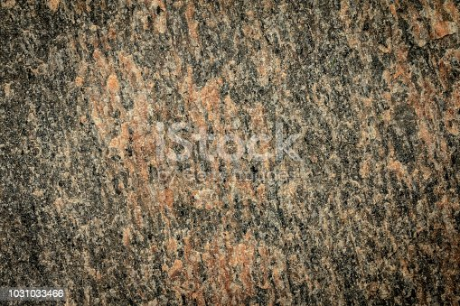 Home construction planning and design for earth tone walls and floors using natural stone and rock for building materials.