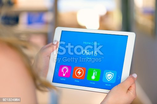 1158812288istockphoto Home control centre on a digital tablet inside a house. 921324984