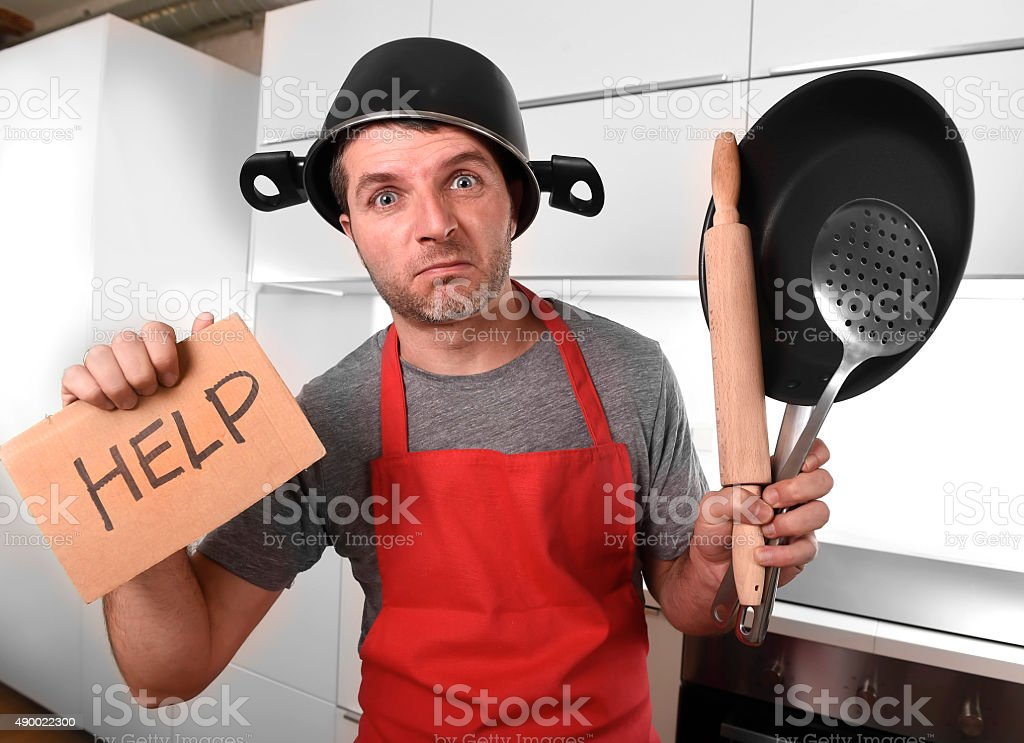 home cook with pot on head asking for help stock photo