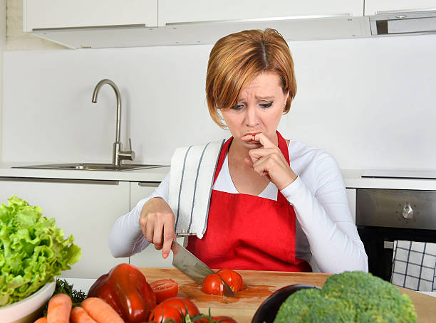 home cook woman suffering domestic accident  knife cutting finger - knife wound stock photos and pictures