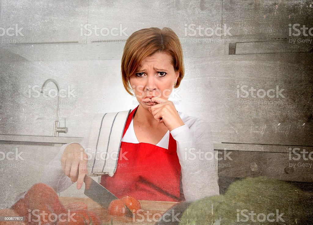 home cook woman suffering domestic accident  knife cutting finger stock photo