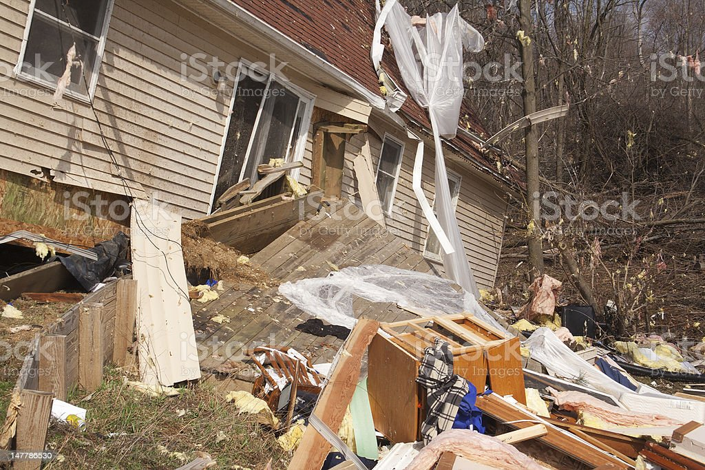 A home heavily damaged by an F2 tornado that swept through Oregon Twp...
