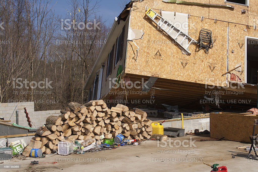 \'Lapeer County, MI, USA - March 16, 2012: A home heavily damaged by...