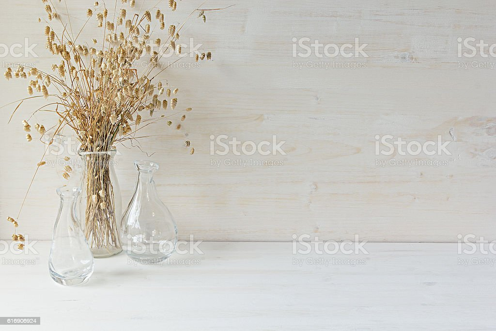 Home decor of   vase with spikelets on white wood background. stock photo