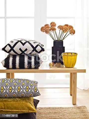 Chic home accessories in front of a window