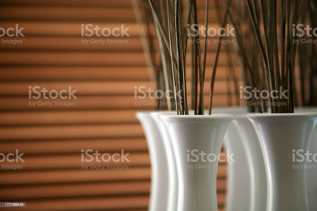 Home decor white vase with timber blinds in background focus on rim of vase Blinds Stock Photo