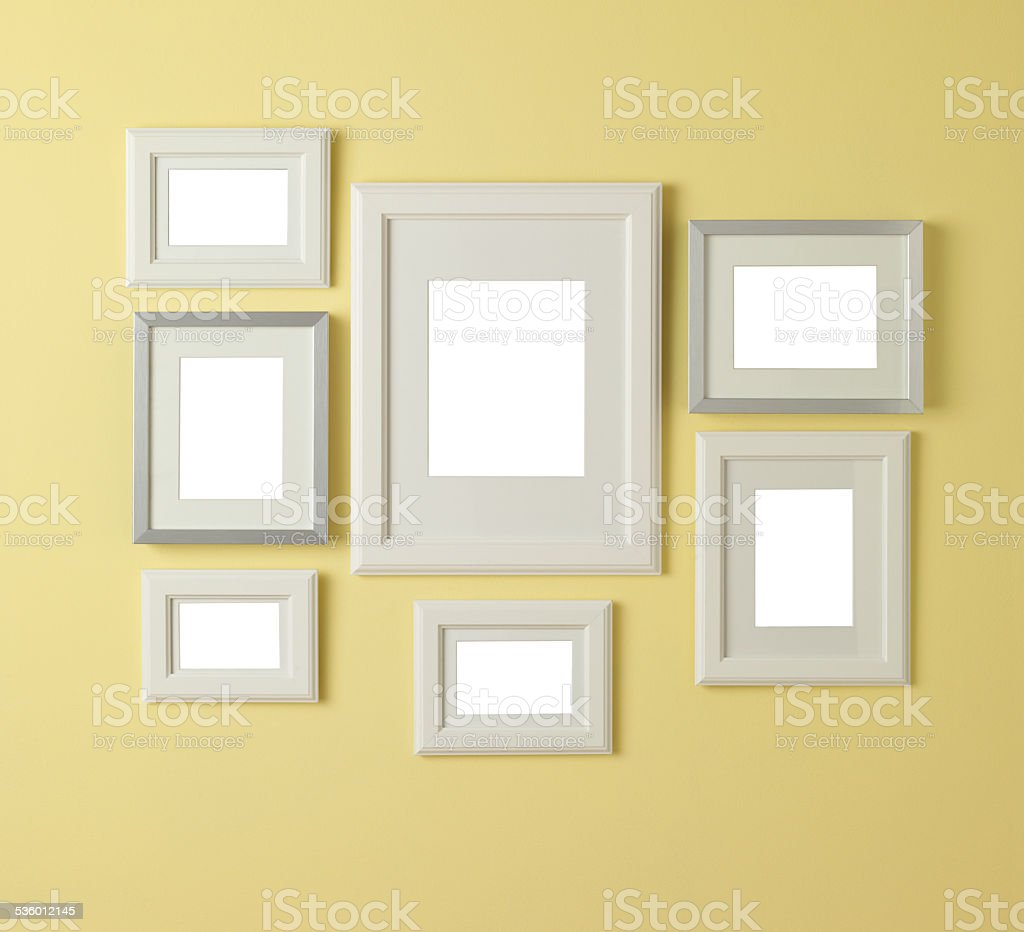 Home Decor Seven Blank Picture Frames Hanging On Yellow Wall Stock ...