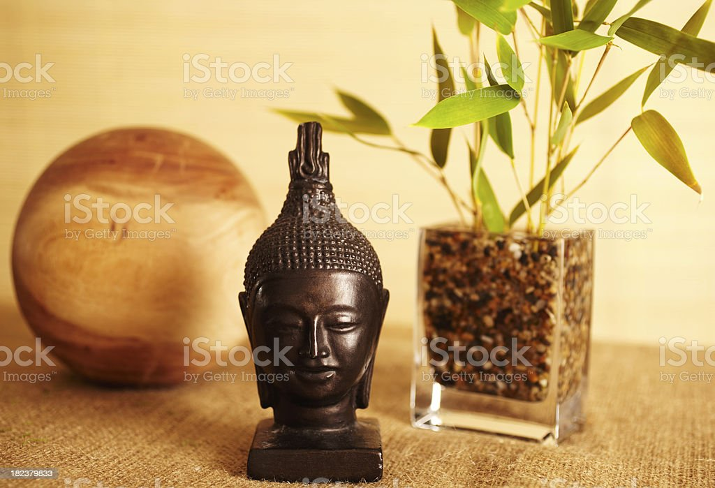 Home decor still life of bamboo in vase  and buddha royalty-free stock photo